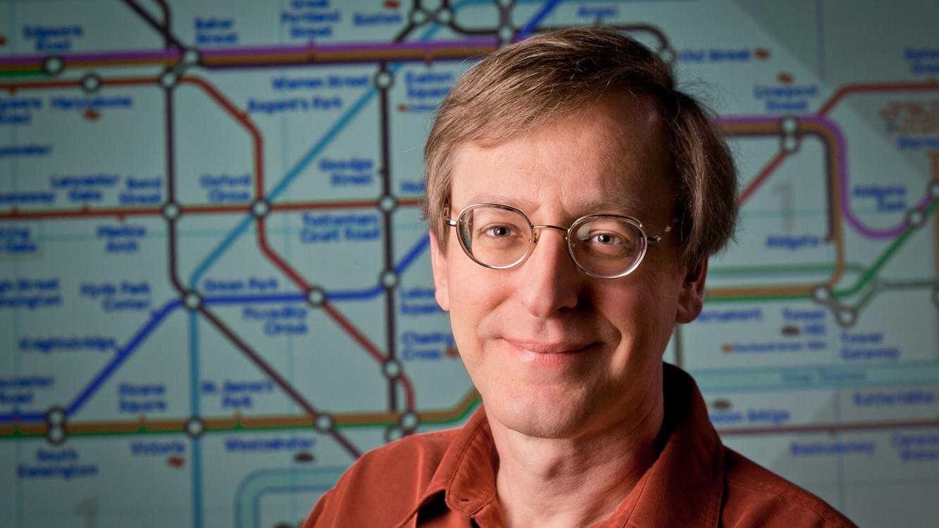 David Beratan in front of a map